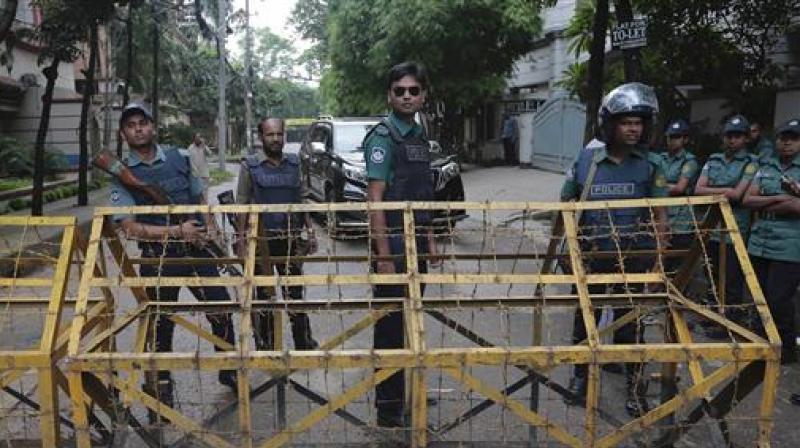 Police blocking access to streets near the Holey Artisan Bakery in Dhaka's Gulshan. (Photo: AP)n. (Photo: AP)
