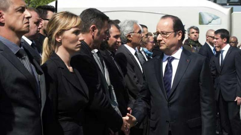 French President Francois Hollande shakes hands with people during a memorial ceremony honouring the police couple who were killed by ISIS group. (Photo: AFP)