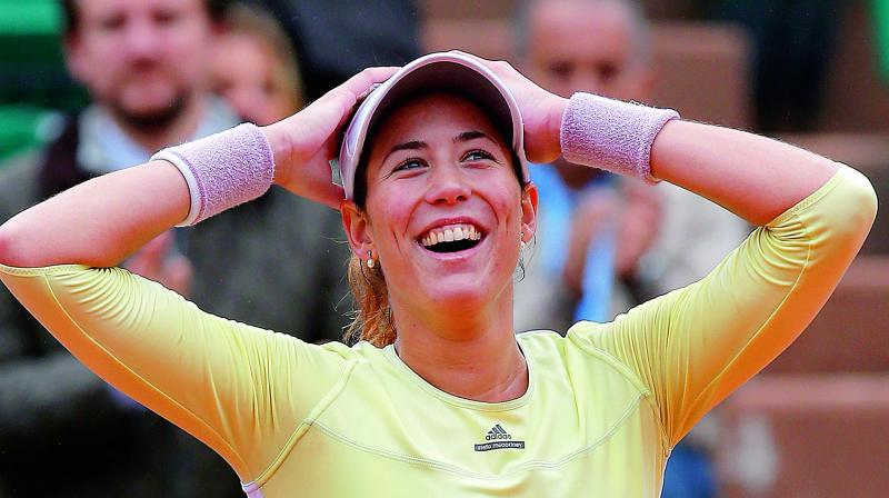 Spain's Garbine Muguruza is ecstatic after defeating Samantha Stosur of Australia in their French Open semifinal at the Roland Garros stadium in Paris on Friday (Photo: AP)