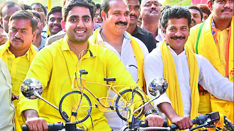 TDP coordinator Nara Lokesh taking out a bike rally for the upcoming GHMC polls in the city. 	— DC