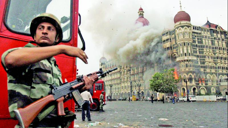 Smoke is seen billowing out of the Taj Hotel in south Mumbai during security personnel's 'Operation Cyclone' following the 26/11 attacks in 2008. (Photo: PTI)