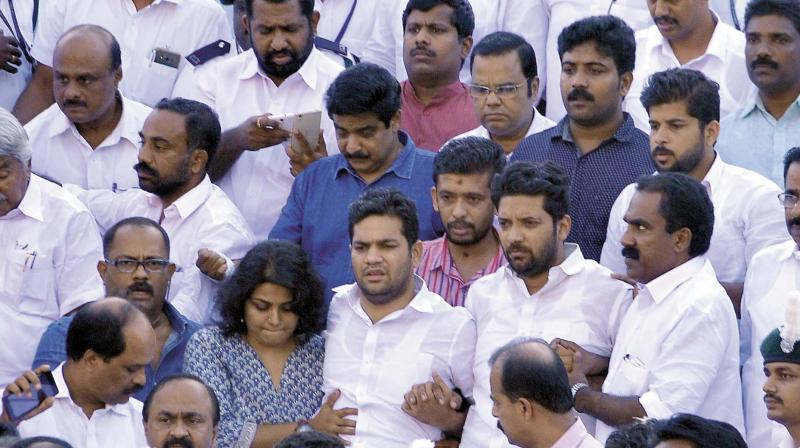 Congress MLAs Hibi Eden and Shafi Parambil, who were staging an indefinite fast at the Legislative Assembly, being taken to medical college hospital by fellow MLAs in Thiruvananthapuram on Tuesday. Hibi's wife Anna Linda is also seen. (Photo: A.V. MUZAFAR)