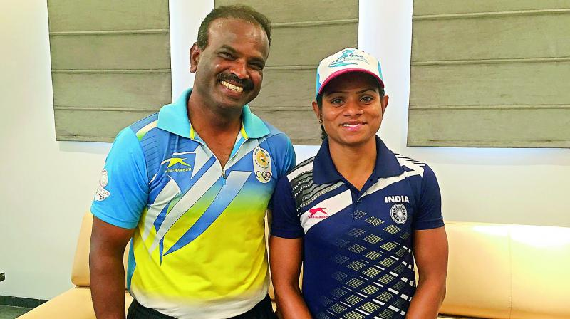 Dutee Chand (right) poses with her coach N. Ramesh in Hyderabad in this file photo.— Deccan Chronicle