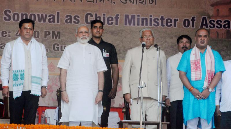 Prime Minister Narendra Modi and Assam Governor PB Acharya with the newly sworn-in Assam Chief Minister Sarbananda Sonowal and Ministers at the swearing-in ceremony at Veterinary College play ground, Khanapara in Guwahati. (Photo: PTI)