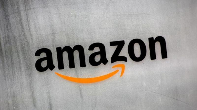 Amazon.com's logo is seen at Amazon Japan's office building in Tokyo, Japan, August 8, 2016. REUTERS/Kim Kyung-Hoon
