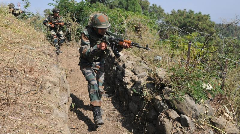 Indian Army soldiers take positions during their patrol near the Line of Control. (Photo: PTI)