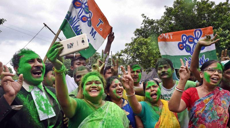 Trinamool Congress supporters celebrate the party's thumping victory in West Bengal Assembly eections. (Photo: PTI)