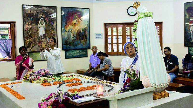 Worshippers gather around the tomb of Mother Teresa inside the Mother house in Kolkata on Saturday. (Photo: AP )