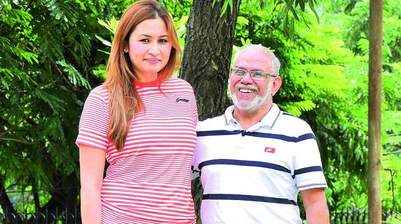 Jwala Gutta with coach S.M. Arif