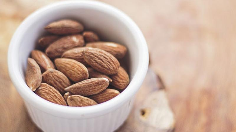 Almonds have been associated with lower blood pressure and cholesterol levels, as well as reduced hunger and weight gain. (Photo: Pixabay)