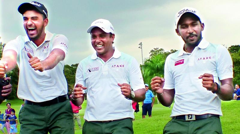 Take Chennai's S.S.P. Chawrasia (from left), Khalin Joshi and S. Chikkarangappa celebrate their victory in the fifth edition of the Louis Philippe golf tournament at the Karnataka Golf Association in Bengaluru on Saturday. (Photo: R. Samuel)
