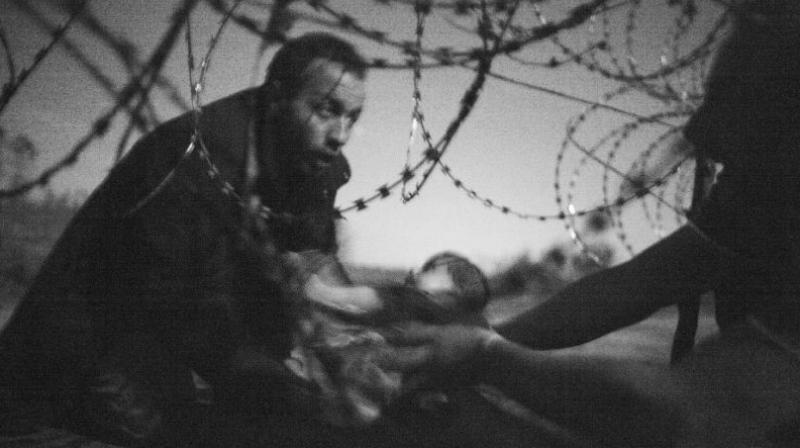 The picture titled 'Hope for a New Life' captures the drama of one crossing on the Serbo-Hungarian border. (Photo: AFP)