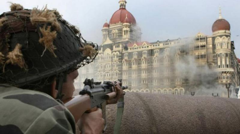 A file photo of Taj Mahal hotel during a gun battle between security forces and militants inside the hotel in Mumbai in 2008. (Photo: AFP)
