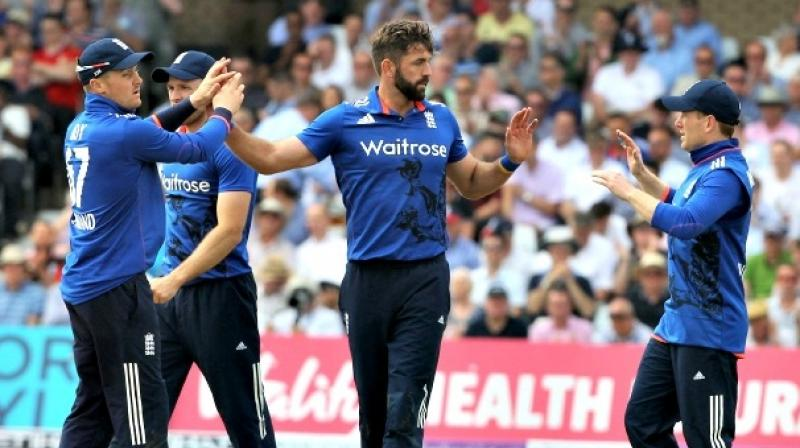 Tailender Liam Plunkett hit a six off the last ball of the match as England achieved a remarkable tie in the first one-day international against Sri Lanka in Nottingham. (Photo: AFP)