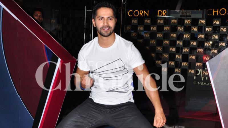 Bollywood star Varun Dhawan was charged up and ready to catch the special screening of Hollywood superhero flick Captain America: Civil War on Saturday night. Photo: Viral Bhayani