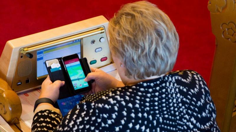 Norwegian Prime Minister Erna Solberg playing Pokemon Go. (Photo: Twitter)