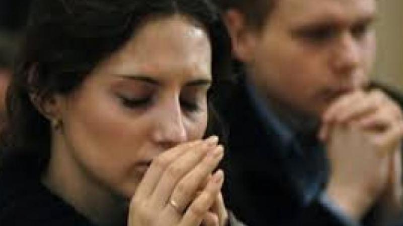 Praying (Photo: AP)
