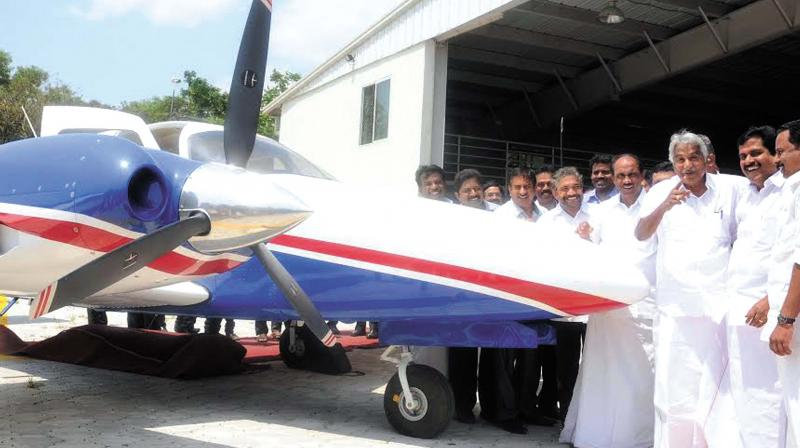 Chief Minister Oommen Chandy, Minister for Fisheries, Ports and Excise K Babu and Health Minister V.S. Sivakumar at the inauguration of the air ambulance project in Thiruvananthapuram on Wednesday . (Photo: A.V. MUZAFAR)