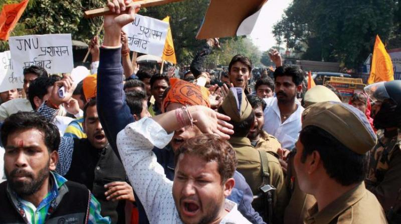 Students affliated to ABVP protest Afzal Guru event on JNU campus. (Photo: PTI)