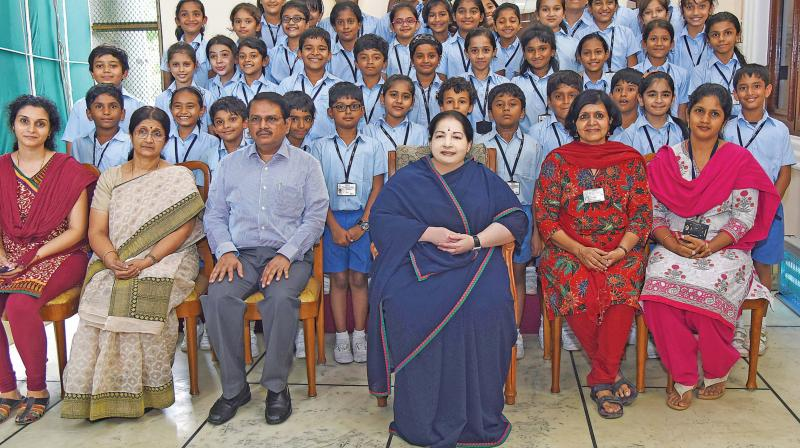 Chief Minister J. Jayalalithaa with students of Adyar's Sishya school in Chennai on Monday. (Photo: DC)