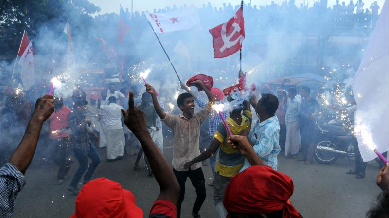 CPM workers celebrate on the streets of Kerala after the Left Front stormed back to power in the state. (Photo: Arunchandra Bose/ Deccan Chronicle)