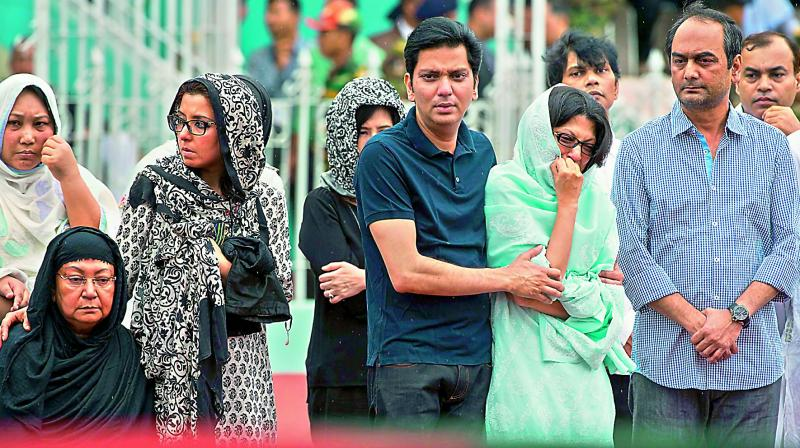 Relatives of Bangladeshi victims of the attack on Holey Artisan Bakery pay tribute to the deceased, at a stadium in Dhaka, Bangladesh. (Photo: AFP)