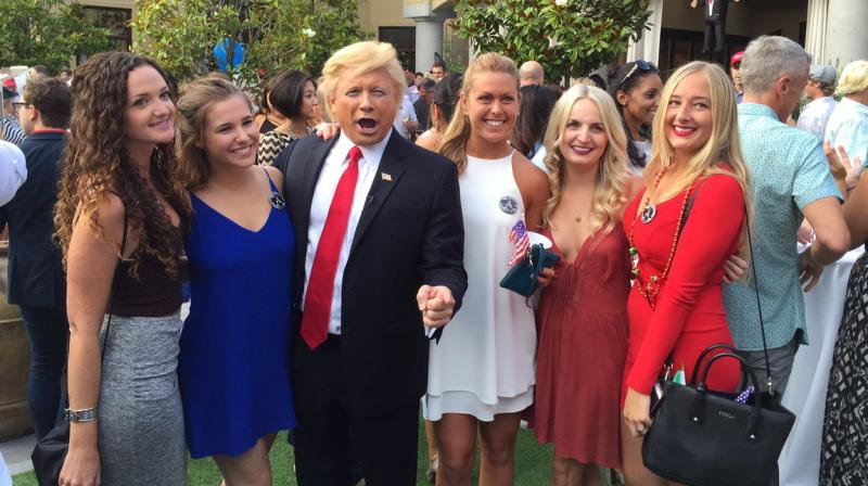 John Di Domenico poses for a photograph at a private party. (Photo: Twitter)