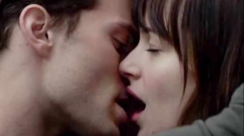Sexually satisfied men and women are more likely to give and receive oral sex, experienced more consistent orgasms and have sex on a frequent basis with their partner. (Screen grab/ Fifty Shades of Grey)