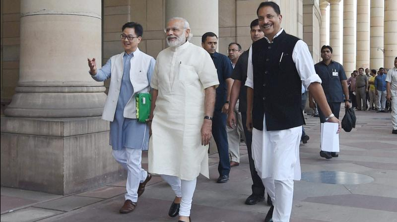 Prime Minister Narendra Modi with other ministers at the Parliament House, in New Delhi. (Photo: PTI)