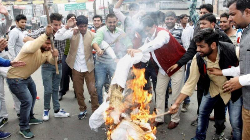 Officials in an attempt to save their lives didn't take any action and let violence take its own course in Haryana during the protest. (Photo: PTI)