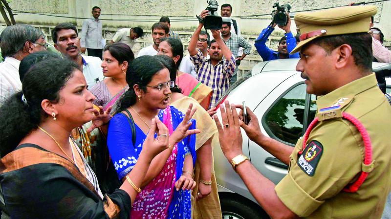 Judicial officers argue with a police officer in Hyderabad on Sunday. 	(Photo: DC)