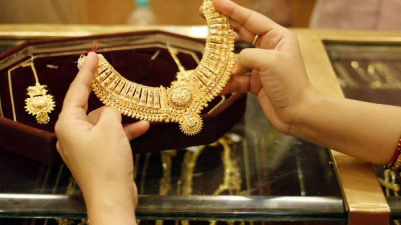 Reversing its two-day losing streak, gold recovered by Rs 10 to Rs 30,850 per 10 grams, driven by a firm trend overseas amid scattered buying by local jewellers.