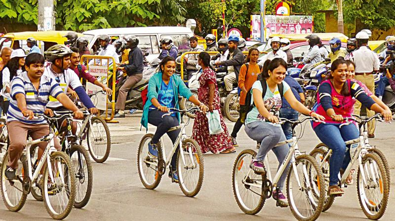 Cyclists on MG Road as part of 'History and Heritage Bicycle Ride' to mark World Tourism Day on Tuesday (Photo: DC)