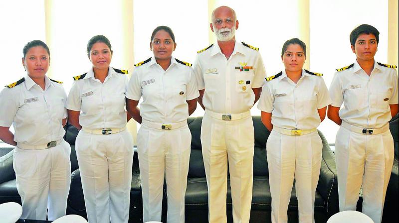 Commander Dilip Donde along with the first Indian women crew of Mhadei at Visakhapatnam on Wednesday. The Mhadei is circumnavigating the world. (Photo: DC)