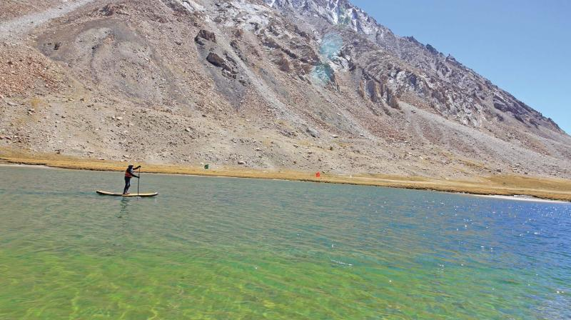 Kumaran paddles across the Himalayan lake of Tsoltak near Chang la pass at an altitude of  16, 618 feet. (Photo: DC)