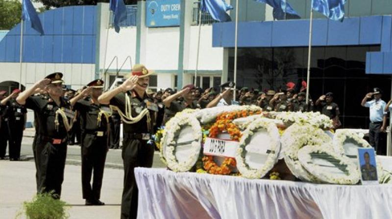 The body of Maj Deswal was brought in a chopper from Delhi to Jhajjar police lines. From police lines, his body, wrapped in a tricolour, was taken to his home. (Photo: PTI)