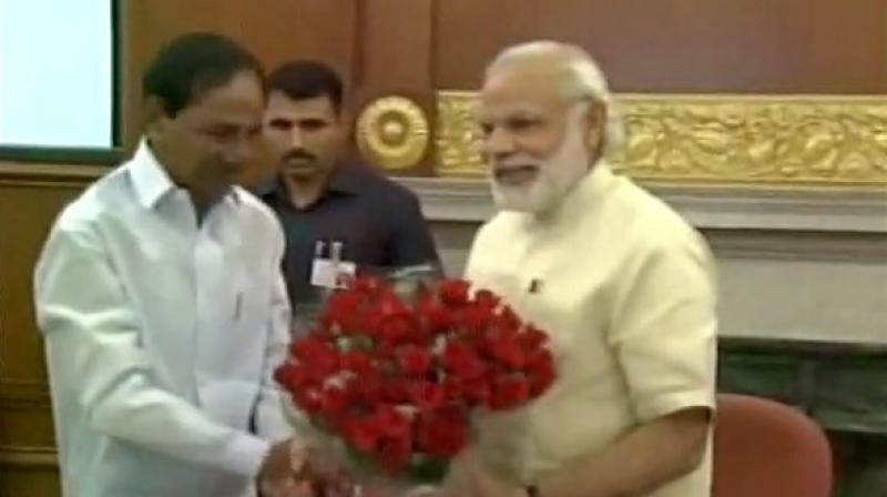 Prime Minister Narendra Modi with Telangana Chief Minister KCR. (Photo: ANI/Twitter)