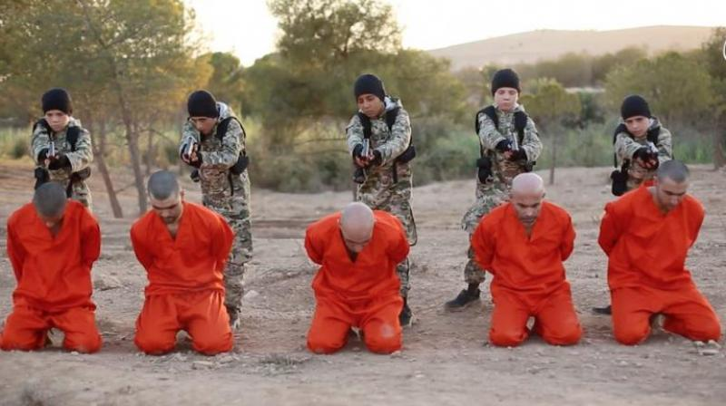 In the video, five hostages are shown dressed in familiar orange jumpsuits seen in previous ISIS propaganda videos. (Photo: YouTube Screengrab)