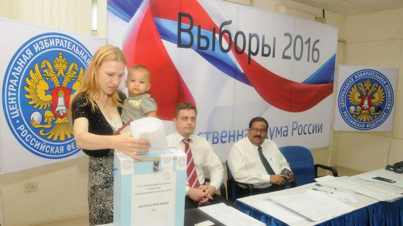 Russian voter Sofiya with her son Arjun casts her vote at the Russian Cultural Centre in Thiruvananthapuram on Friday.  (Photo: A.V. MUZAFAR)