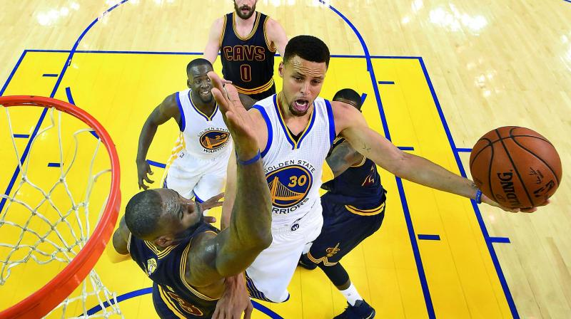 754a1c37f2b5 Golden State Warriors guard Stephen Curry (30) shoots over Cleveland Cavaliers  forward LeBron James