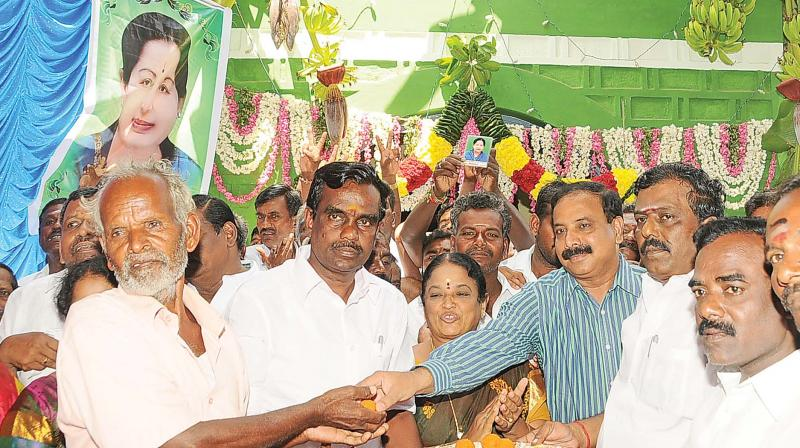 Thiruvannamalai district collector A. Gnanasekaran distributes sweets after the inaugration of the new taluk office on Saturday. (Photo: DC)