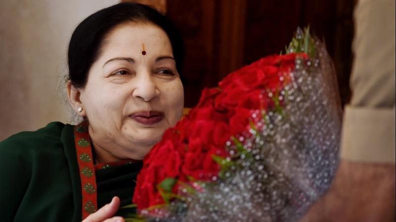 Tamil Nadu Chief Minister and AIADMK Supremo J Jayalalithaa is greeted by a supporter after her party's win in the state Assembly polls. (Photo: PTI)