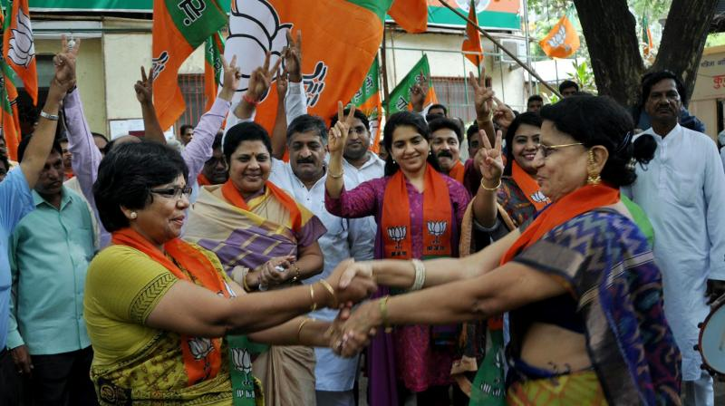 BJP workers celebrate the party's victory in Assam Assembly elections. (Photo: PTI)