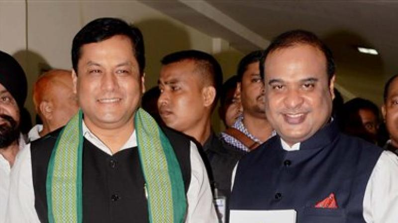 Assam health and education minister Himanta Biswa Sarma (right) with Assam Chief Minister Sarbananda Sonowal. (Photo: PTI/File)