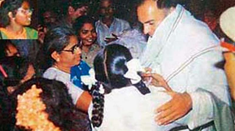 The last picture of Rajiv Gandhi alive, from Haribabu's camera, as the murderous Dhanu, wearing orange flowers (inset) sneaks up right behind a schoolgirl who is interacting with the former prime minister.