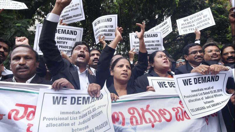 Telangana advocates holding placards at a protest in front of the High Court demanding separate High Court for Telangana (Photo: PTI)