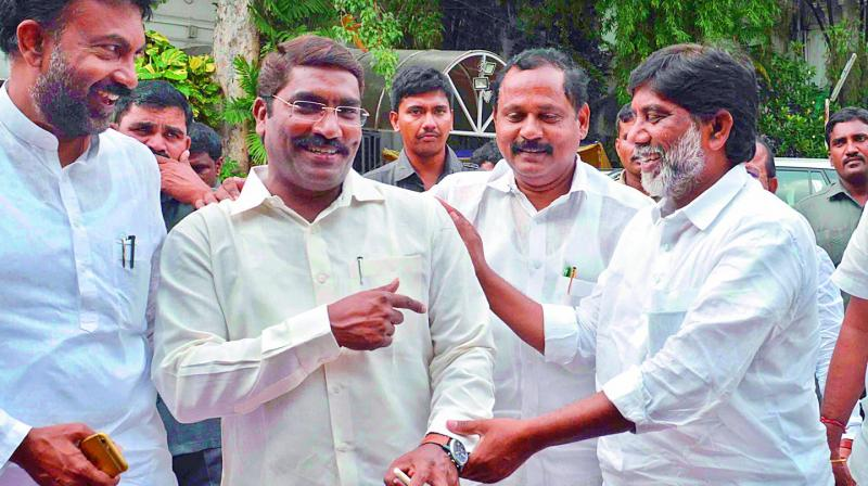 TPCC working president Mallu Bhatti Vikramarka shares a joke with party MLAs Sampath Kumar and T. Ram Mohan Reddy at the media point in the Assembly in Hyderabad on Monday, a day ahead of the special session. (Photo: DC)