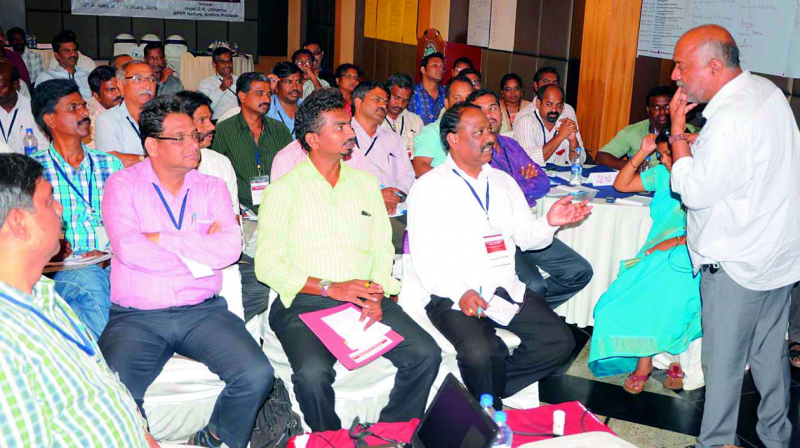 Member of Feedback foundation Ajay from Delhi gives training  to resource persons on total sanitation at a private hotel in Nellore on Monday. (Photo: DC)