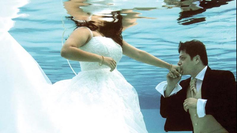 Alisha and Glen in an underwater shoot