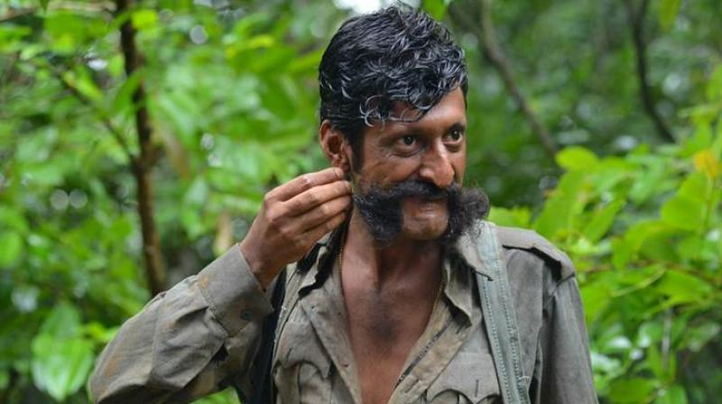 Sandeep's tranformation as Veerappan is commendable -- from his looks to his dialect.